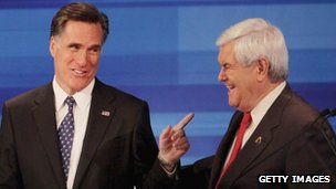 Newt Gingrich (R) and Mitt Romney chat after the debate on 15 December 2011 in