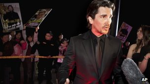 "British actor Christian Bale speaks to journalists on the red carpet as he arrives for an event of the new movie ""The Flowers of War"" in Beijing, China, 12 December 2011"