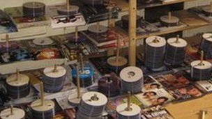 Piles of counterfeit DVDs in private premises