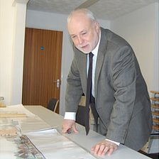 Derek Neale looking at plans for Les Beaucamps High School
