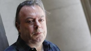 Author Christopher Hitchens poses for a portrait outside his hotel in New York, June 2010
