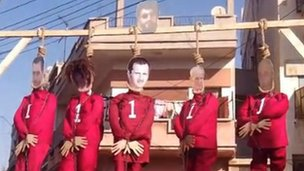 Video posted online showing protest in Khaldieh, Homs, where five effigies were hanged, including one of President Bashar al-Assad (16 December 2011).