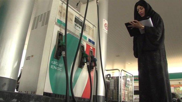 Girl at petrol pump