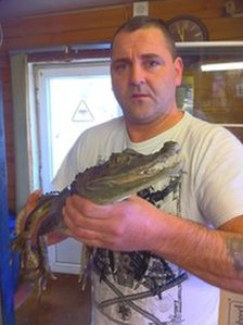 South American crocodile with shop owner Jimmy Wicks