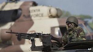 A Kenyan soldier on an armoured vehicle at their base near the Bur Garbo, Somalia, 14 Dec 2011
