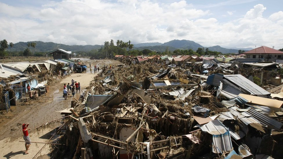 Collapsed houses in Iligan, southern Philippines, 18 December