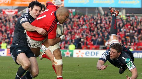 Stephen Jones tackles Munster wing Simon Zebo close to the Scarlets line`
