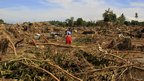 Villagers search for relatives in the Cagayan de Oro area, Philippines, 18 December