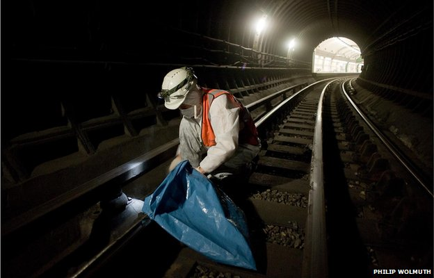 A member of the Deep Cleaning Gang employed by a sub-contractor working through the night at Edgware Road tube station on the Bakerloo Line