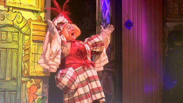 Pantomime dame on stage