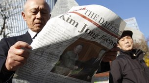 A man reads an extra edition of a newspaper reporting on the death of North Korean leader Kim Jong-il, at Tokyo's Ginza shopping district, December 19, 2011.