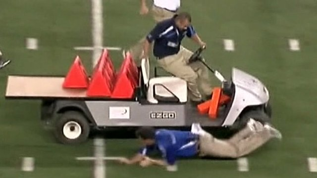 Men try to stop runaway golf cart