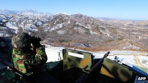 A South Korean soldier keeps watching North Korea at an outpost in Goseong near the Demilitarized Zone (DMZ) dividing the two Koreas on December 19, 2011