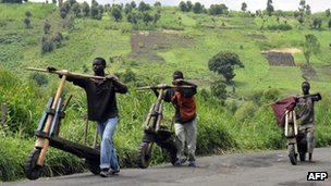 Young men push wooden bicycles in the Democratic Republic of Congo&#039;s North Kivu province on 4 December 2011.