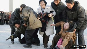Pyongyang residents mourn the death of Kim Jong-il