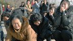 Pyongyang residents react to the death of North Korean leader Kim Jong-il