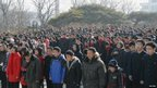 Pyongyang residents gather as they mourn over the death of North Korean leader Kim Jong-il