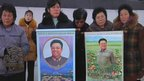 North Korean gather in Pyongyang's main square with pictures of Mr Kim
