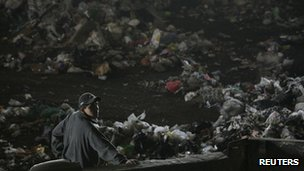 A man stands near waste at the Bordo Poniente landfill site outside Mexico City