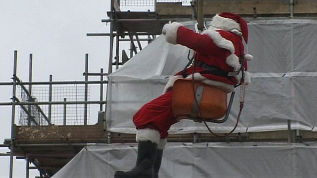 Father Christmas gets a lift to help him down Leo's chimney in the Cotswolds