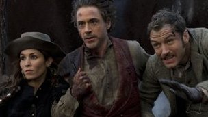 Noomi Rapace, Robert Downey Jr and Jude Law in Sherlock Holmes: A Game Of Shadows
