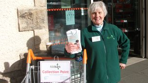A North Lakes Foodbank volunteer raises publicity about the scheme