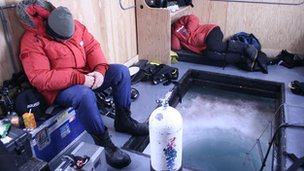 Hugh Miller and Doug Anderson sleeping between dives