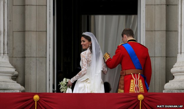 Kate, Duchess of Cambridge, and Prince William go back inside having greeted the crowds on the balcony of  Buckingham Palace