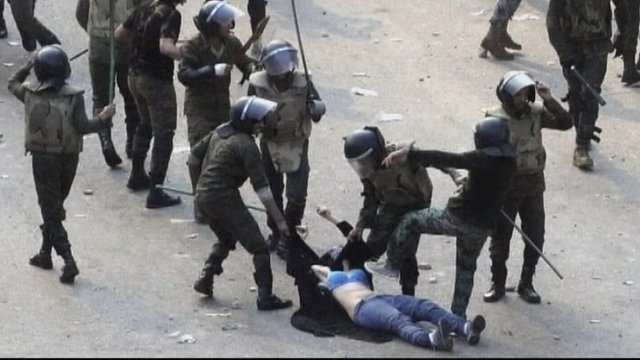 Woman being beaten by Egyptian troops