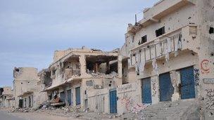Damaged buildings in Sirte