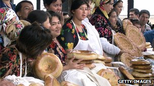 Uzbek women sell bread at a market in the ancient city of Samarkand
