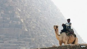 A camel-mounted Egyptian tourism policeman keeping vigil on the Giza plateau near Cairo. File photo