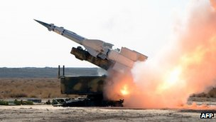 A photo released by the Sana news agency, showing a missile launch during military exercises in Syria 