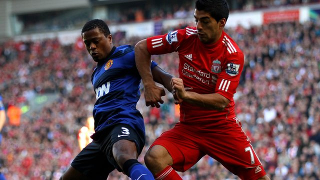 Patrice Evra and Luis Suarez