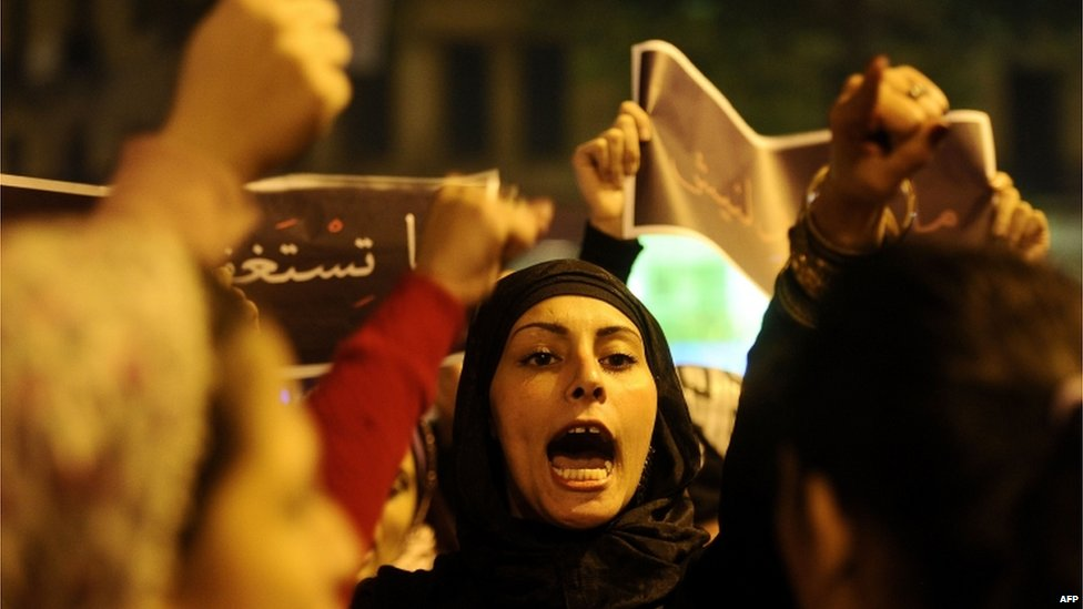 An Egyptian woman shouts slogans during a protest in downtown Cairo