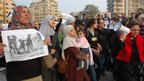 Egyptians hold signs during a protest organised by women in Cairo (20 December 2011)