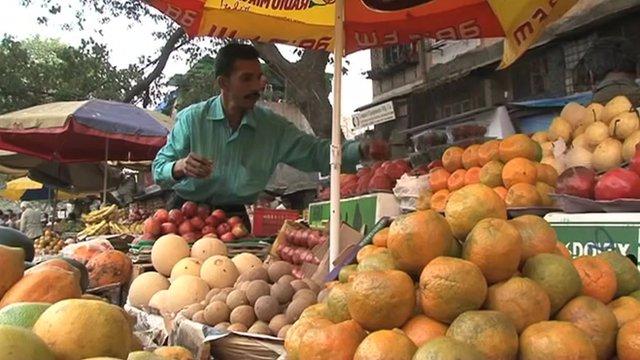 A market trader selling fruit in Mumbai