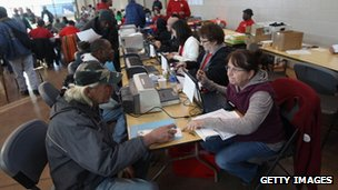 Homeless US military veterans receive information on free government services at a 'Stand Down' event in Denver, Colorado, 3 November 2011