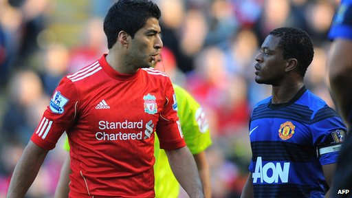 Liverpool's Luis Suarez and Manchester United's Patrice Evra exchange words during the Premier League match at Anfield.