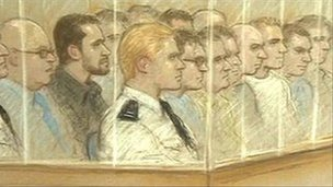 Artist&#039;s impression of the defendants and prison officers in the dock