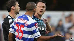 England and Chelsea captain John Terry (right) speaking with QPR&#039;s Anton Ferdinand during their teams&#039; Premier League match at Loftus Road