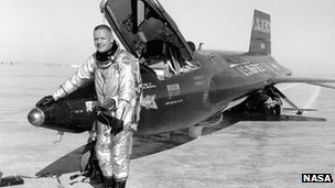 Neil Armstrong standing by the X-15