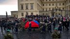 The horse-drawn hearse carrying the flag draped coffin of former Czech President Vaclav Havel as it arrives at the Castle in Prague on 21 Dec 2011