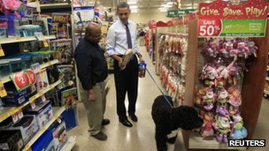 US President Barack Obama buys a bone for his dog 21 December 2011