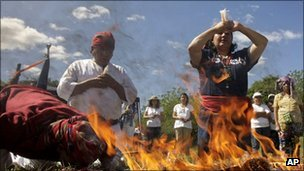 Mayan priests make offerings before a fire in San Andres, El Salvador