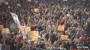 Demonstrators in the Baba Amro district of Homs