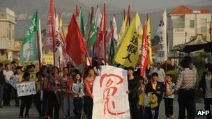 Villagers march in protest in Wukan on 15 December 2012