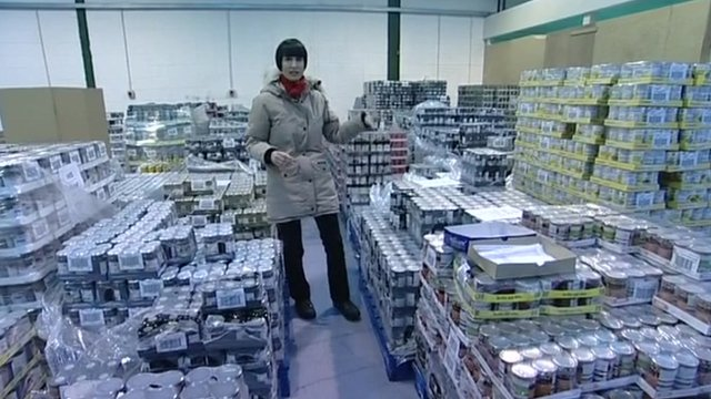 Fiona Trott in a warehouse full of donated food
