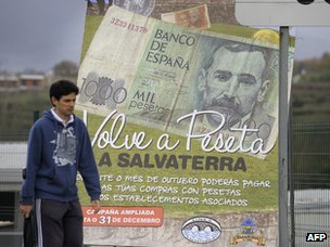 Poster showing peseta note in Salvaterra, northwest Spain
