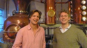 Sam Galsworthy and Fairfax Hall of Sipsmith stand next to their distiller, Prudence